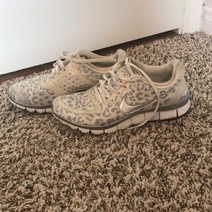 White and silver cheetah Nike tennis shoes